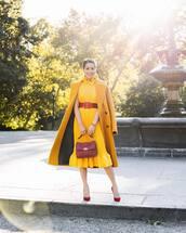 dress,midi dress,yellow dress,ruffle dress,high neck,belted dress,handbag,pumps,coat,wool coat,long coat