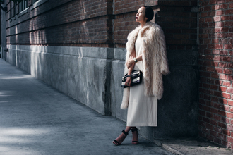 the chriselle factor blogger dress fuzzy coat winter coat pouch black sandals beige fluffy coat white winter outfit