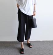 pants,tumblr,black pants,culottes,black culottes,cropped pants,palazzo pants,slide shoes,black slides,t-shirt,black bag,bag,handbag,white t-shirt