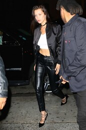 shoes,pumps,bella hadid,leather pants,crop tops,jacket,model off-duty,spring outfits,choker necklace,bomber jacket,Bella Hadid Crop Top,black bomber jacket,satin bomber,pants,white top