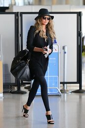 chrissy teigen,blazer,bag,hat,shoes,mules,carry on bag,black fedora,black double strap mules,double strap mules,black mules,guiseppe zanotti,black blazer,black duffle bag,leather duffle bag,gucci bag,fedora,wayfarer,black top,black leggings