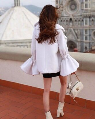 coat tumblr white coat bell sleeves skirt mini skirt black skirt bag white bag gucci gucci bag chain bag boots white boots high heels boots ankle boots