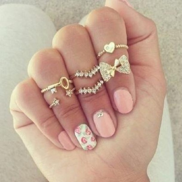 jewels fashion ring knuckle ring bow ring bow chevron chevron ring key keychain gold ring gold gold ring stars star rings stars ring heart heart jewelry heart midi ring cute girly gorgeous pretty pink rosy flowers floral tumblr peach white jewelry coral peachy nail polish bling lovely