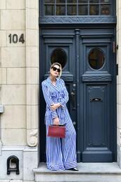 pants,wide-leg pants,blue pants,stripes,striped pants,shirt,striped shirt,blue shirt,bag,sunglasses,power suit,pajama style