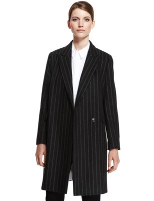 Wool Rich Peak Lapel Pinstriped Coat | M&S | Tap into that androgynous vibe with this fabulous pinstripe coat. The sleek style makes it the perfect work jacket- team it with your smartest suit for a truly masculine touch, or throw it over your most elegant dress.