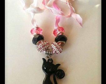 Black cat ribbon on etsy, a global handmade and vintage marketplace.