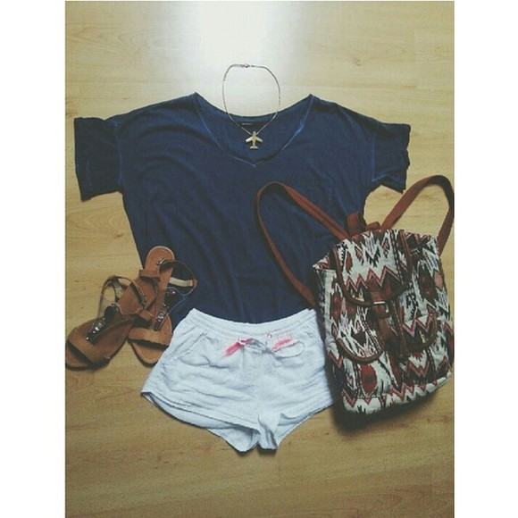 tribal pattern t-shirt blue t-shirt gold necklace airplane aztec bag white short casual outfit ootd chic everyday wear summer outfits lifestyle shoes simple