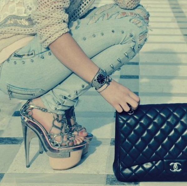 pants spikes ripped jeans shirt shoes heels wedges jeans nitter chanel high heels silver shoes handbag bag blue jeans chanel bag cute high heels edgy silver shoes
