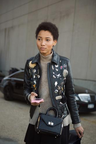 man repeller blogger leather jacket patch turtleneck black bag black skirt