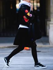 jacket,fashion week 2017,tumblr,black jacket,bomber jacket,black bomber jacket,patch,hoodie,white hoodie,athleisure,skirt,black skirt,midi skirt,backpack,black backpack,tights,opaque tights,sneakers,vans,vans outfits,black sneakers,high top sneakers,streetstyle