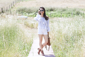 it's not her it's me,blogger,top,shorts,bag,shoes,sunglasses,striped off shoulder top,blouse,bell sleeves,bel sleeve top,off the shoulder,off the shoulder top,blue sunglasses,boots,ankle boots,brown boots,high heels boots,brown bag,white shorts