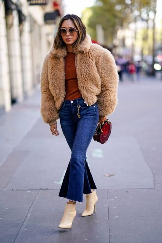 jacket acne studios fur jacket nude jacket camel song of style top blogger lifestyle denim jeans blue jeans kick flare cropped jeans boots white boots ankle boots sunglasses