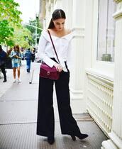 bag,eco friendly,red bag,burgundy,shirt,white shirt,off the shoulder,off the shoulder top,pants,black pants,wide-leg pants,boots,black boots