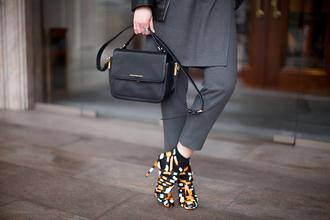 fashion agony blogger print boots black bag grey pants