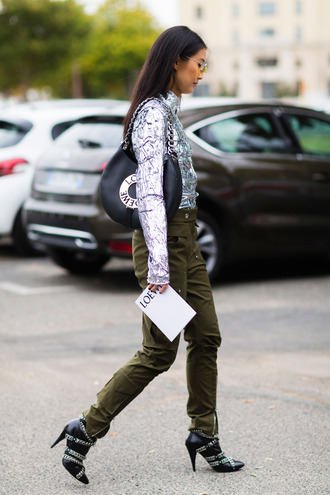 pants silver top fashion week street style fashion week 2016 fashion week paris fashion week 2016 green pants loewe bag black bag bag boots black boots chain boots high heels boots top silver streetstyle metallic blouse sequin blouse
