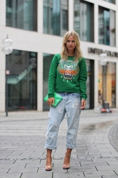 sweater,sports sweater,green sweater,printed sweater,denim,jeans,cropped jeans,light blue jeans,clutch,pouch,sandals,sandal heels,high heel sandals,clear sandals,streetstyle,graphic sweatshirt