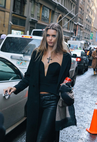 top nyfw 2017 fashion week 2017 fashion week streetstyle 00s style black top black crop top crop tops plunge v neck v neck tube top coat black coat pants black pants black leather pants leather pants all black everything necklace cross