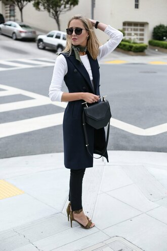 the classy cubicle blogger jacket jeans t-shirt shoes bag jewels vest blue vest black bag top long sleeves white top pants black pants scarf sunglasses black sunglasses sandals sandal heels high heel sandals khaki shoes