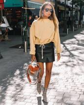 skirt,mini skirt,wrap skirt,leather skirt,sock boots,handbag,sweater,earrings,sunglasses