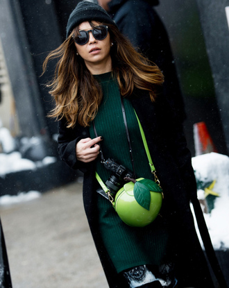 dress tumblr nyfw 2017 fashion week 2017 fashion week streetstyle bag green bag green dress knitwear knitted dress mini knit dress sweater dress coat black coat sunglasses black beanie beanie