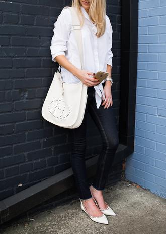 krystal schlegel blogger shirt jeans valentino rockstud studded shoes pointed flats flats white flats white shirt white bag hermes hermes bag skinny jeans blue jeans