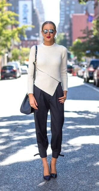 top asymmetrical top asymmetrical white top sweater pants grey pants striped pants stripes cropped pants pumps black pumps high heel pumps bag black bag mirrored sunglasses silver sunglasses
