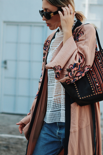 the fashion sight blogger pink coat embroidered eyelet top eyelet detail lace top black bag black sunglasses kimono dusty pink pink kimono chanel sunglasses crochet blouse boyfriend jeans spring outfits boho chic
