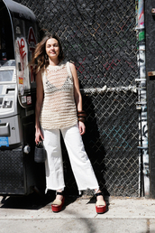 man repeller,blogger,knitwear,white jeans,platform shoes,cropped jeans,knitted top,Cropped Flared Jeans,simon miller bag