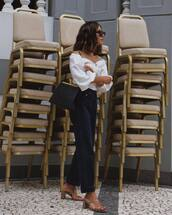 top,white top,off the shoulder top,black jeans,mules,sunglasses