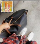 bag,black,duffle,megan batoon,brown straps,brown,leather,black duffle bag,leather bag