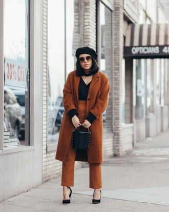 natymichele blogger coat top pants bag shoes beret winter outfits brown coat bucket bag