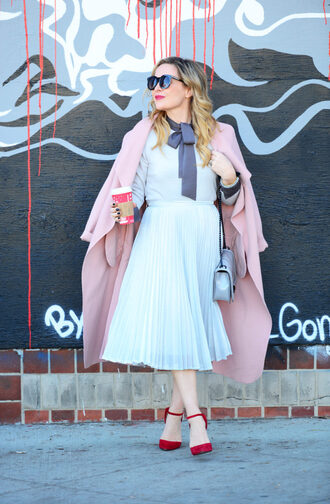 thehuntercollector blogger skirt blouse sweater coat shoes bag sunglasses jewels pink coat winter outfits pleated skirt shoulder bag red heels high heel pumps