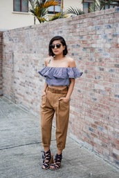 little miss violet,blogger,ruffle,ruffled top,striped top,peasant top,off the shoulder top,cropped pants,lace-up shoes,wedges,wedge sandals,spring outfits,blue off shoulder top,striped off shoulder top,crop tops,pants,camel pants,sandals,lace up heels,sunglasses