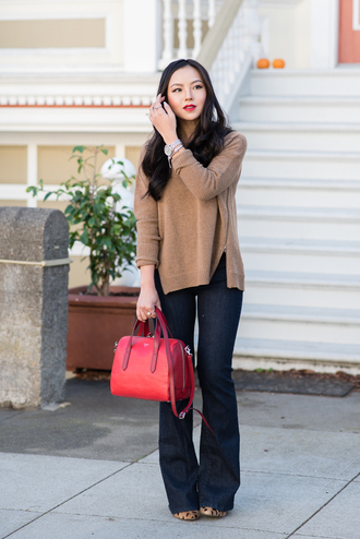 the fancy pants report blogger jewels jeans make-up flare animal print watch jumper red bag