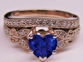 jewels,ring,hearr,blue,gold,wedding,heart jewelry,heart,engagement ring,blue wedding accessory