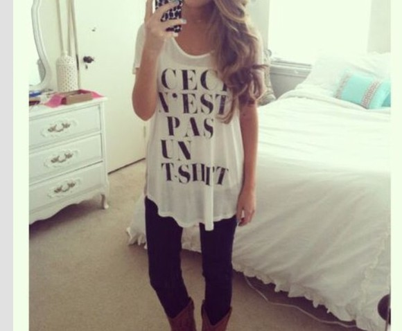white top french quote on it