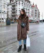 coat,tumblr,brown coat,long coat,teddy bear coat,denim,jeans,blue jeans,cropped jeans,winter outfits,winter coat,winter boots,boots,black boots,bag,crossbody bag