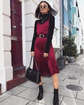 dress,satin dress,midi dress,asymmetrical dress,belted dress,ankle boots,handbag,turtleneck,earrings,sunglasses,shoes,boots,black boots,mid heel boots,shoulder bag,satin,round sunglasses
