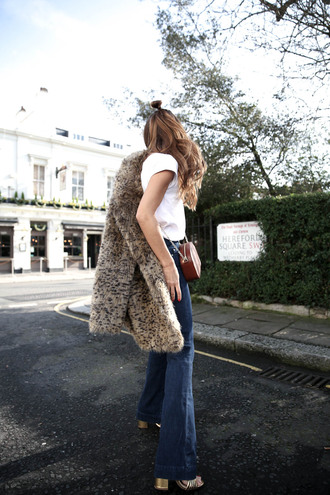 b a r t a b a c blogger coat t-shirt jeans shoes bag faux fur coat flare jeans 70s style tumblr white t-shirt denim blue jeans brown bag chain bag jacket fur jacket brunette long hair hair