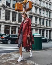 coat,red coat,leather,white sneakers,midi dress,printed dress,handbag,earrings