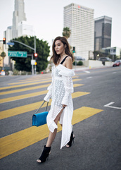 tsangtastic,blogger,off the shoulder,off the shoulder dress,long sleeve dress,white dress,blue bag,peep toe boots,date outfit,slit dress,slide slit,puffed sleeves,cut out shoulder,long sleeves,eyelet detail,eyelet dress,midi dress,booties,puff sleeve dress