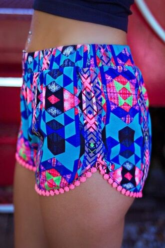 shorts pom pom shorts beach shorts blue printed shorts cute summer shorts bright shorts neon colorful purple bright sportswear pattern neon shorts summer summer outfits sun tassel