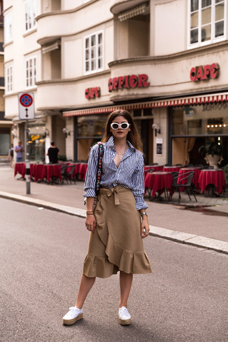 the fashion fraction blogger top skirt shoes bag sunglasses jewels striped shirt midi skirt beige skirt espadrilles summer outfits ruffle hem skirt wrap skirt striped blouse white sneakers shoulder bag blogger style