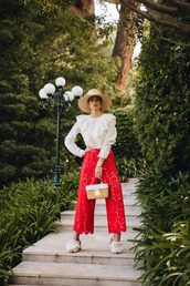 pants,red pants,wide-leg pants,shoes,mules,top,white top,bag,hat,ruffled blouse,straw bag,spring outfits