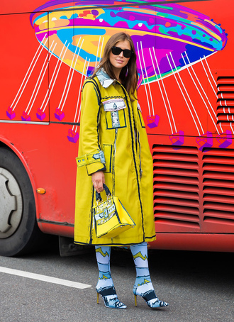 coat stockholm fashion week streetstyle yellow yellow coat rain coat boots sock boots bag yellow bag sunglasses
