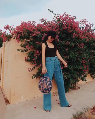 jeans wide-leg pants denim blue jeans top black top tank top bag round bag hat