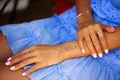 jewels,bracelet chains,knuckle ring,finger rings,tassel,metallic,jewellry,jewellery rings,snake,ethnic