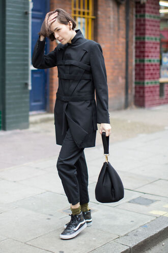coat fashion week street style streetstyle fashion week fashion week 2016 black coat black pants pants cropped pants bag black bag sneakers high top sneakers black sneakers vest socks all black everything fall outfits