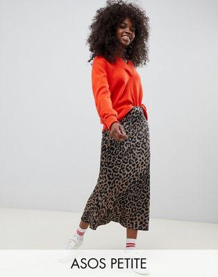 ASOS DESIGN Petite bias cut satin midi skirt in leopard print at asos.com