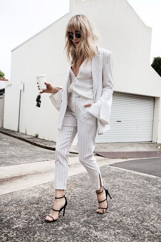 pants striped pants tailoring stripes white pants cropped pants office outfits black sandals blogger white blazer striped jacket brooke testoni all white everything white top round sunglasses sandals sandal heels black heels